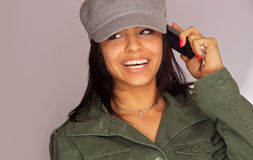Young beauty on cell phone Royalty Free Stock Photography