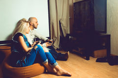 Young beauty couple having fun and playing computer games on tv Stock Photo