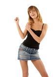 Young beauty dancing. Lovely girl in mini skirti dancing on white background stock photo