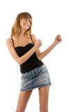 Young beauty dancing. Lovely girl in mini skirti dancing on white background Stock Photos