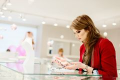 Young beauty elegance woman buying necklace. In jewelry store Stock Images