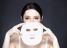 young beauty face and facial mask royalty free stock image