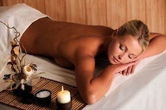 Young beauty female relaxing in spa salon Royalty Free Stock Images