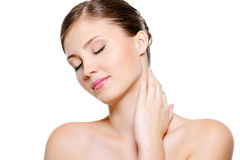 Young beauty female stroking neck Stock Photo