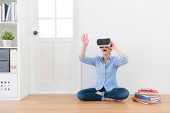 Young beauty female teacher wearing VR technology. Device looking education information and using hands to organize school teaching class content stock image