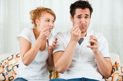 Young, beauty girl and boy eating yoghurt stock images