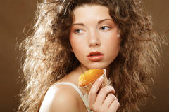 Young beauty girl with cake Royalty Free Stock Photography