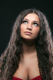 Young beauty girl with long curly hair royalty free stock images