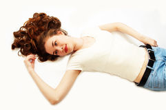 Young beauty girl is lying. On white stock photo