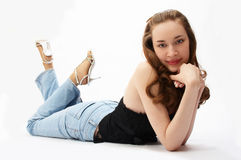 Young beauty girl is lying. On white Royalty Free Stock Image