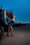 Young beauty girl posing near steel truck Royalty Free Stock Image