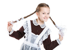 Young beauty smiling girl in school clothing Royalty Free Stock Photography