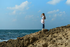 Young Beauty Girl By Sea Coast. Under Sunlight Stock Photography