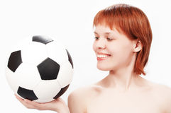 Young beauty girl with soccer ball. On white stock photography