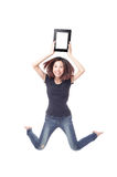 Young beauty happy jump and showing tablet pc Royalty Free Stock Photos