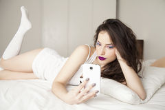 Young beauty holding smartphone Stock Photo