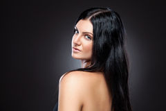 Young beauty with long dark hair Royalty Free Stock Photo