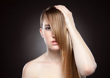 Young beauty with long hair Stock Image