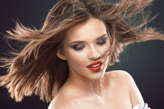 Young beauty model with blowing hair. Royalty Free Stock Image