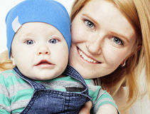 Young beauty mother with cute baby, red head happy modern family isolated on white background close up, lifestyle people Stock Photo
