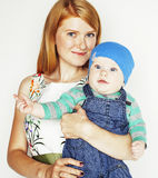 Young beauty mother with cute baby, red head happy modern family Stock Image