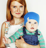 Young beauty mother with cute baby, red head happy modern family Stock Photos