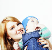 Young beauty mother with cute baby, red head happy modern family. Smiling isolated on white background close up, lifestyle people concept Stock Photography