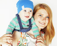 Young beauty mother with cute baby, red head happy modern family. Smiling  on white background close up, lifestyle people concept Stock Images