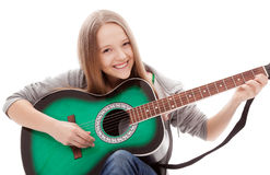 Beautiful girl with guitar on white background. Young beauty music girl with guitar on white background stock photo