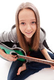 Beautiful girl with guitar  on white background Royalty Free Stock Photography