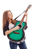 Beautiful girl with guitar  on white background. Young beauty music girl with guitar on white background Royalty Free Stock Images