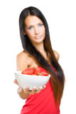 Young beauty offering strawberries. Royalty Free Stock Photo