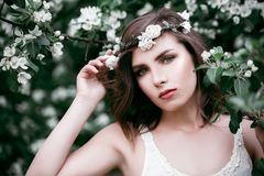 Young Beauty Outdoors. Cute Woman Fashion Model with Flowers Stock Photo