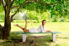Young beauty in park Stock Images