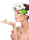 Young beauty with perfect skin wearing a crown from flowers Stock Photos