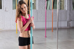 Young beauty pole dancer Stock Photo