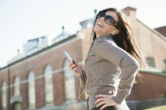 Young beauty posing over city background Stock Photos