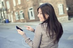Young beauty posing over city background Stock Photography