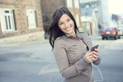 Young beauty posing over city background Stock Images