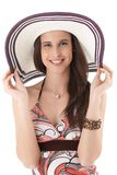 Young beauty posing in straw hat Stock Photography