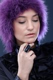Young beauty in purple wig Stock Image