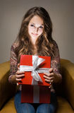 Young beauty with red gift box. Stock Photo