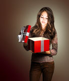 Young beauty with red gift box. Stock Images