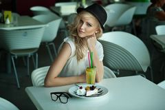 Young beauty in a restaurant Royalty Free Stock Images