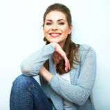 Young beauty seating woman casual style dressed. Royalty Free Stock Image
