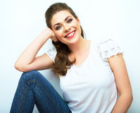 Young beauty seating woman casual style dressed. Royalty Free Stock Images