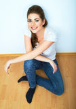 Young beauty seating woman casual style dressed. Royalty Free Stock Photography