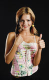 Young beauty showing thumb up sign. Black background - very high resolution Royalty Free Stock Images