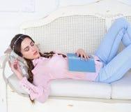 Young beauty sleeping on sofa Royalty Free Stock Photo