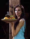 Young beauty with tequila in the old wooden house Stock Photos